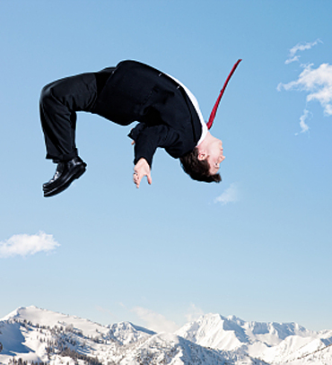Businessman Backflip in Winter Mountains